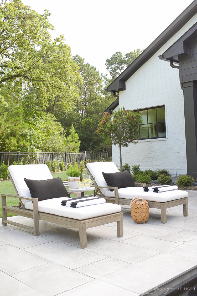 Walmart Home outdoor patio with loungers and black and white outdoor decor
