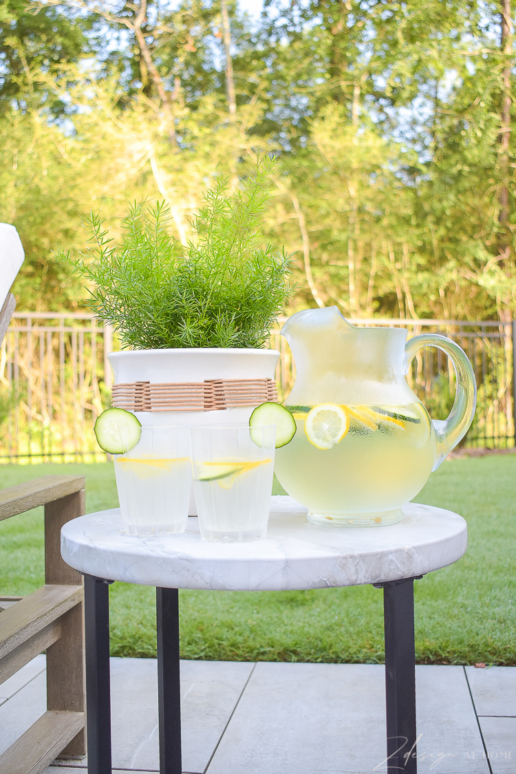 walmart home outdoor serving - elegant plastic glasses, water pitcher and raffia planter pot, faux marble top side table