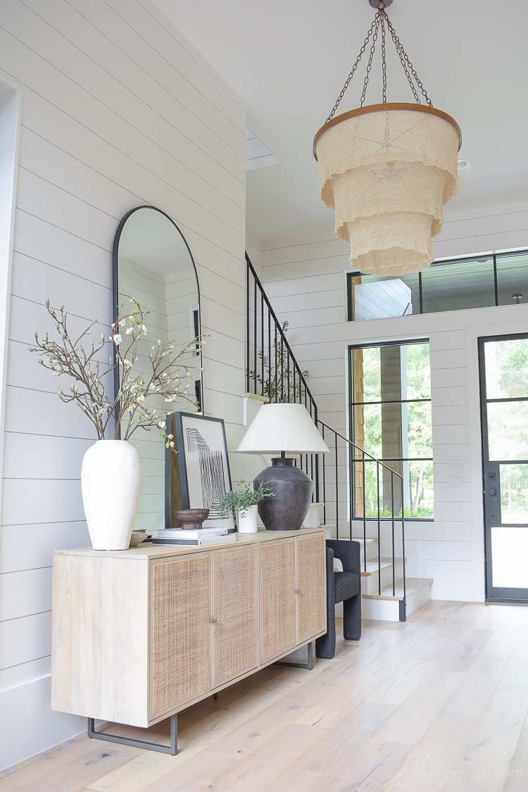 grand entryway styled with large roundd patricia chandelier