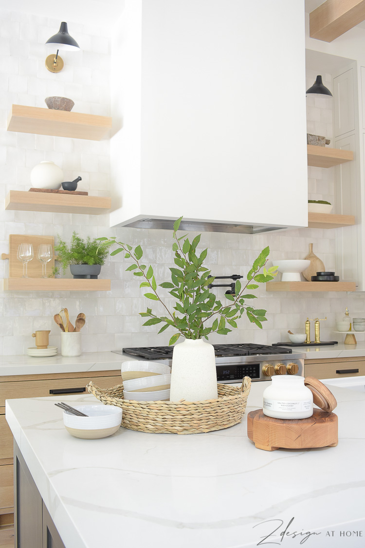 summer kitchen styled with basket, vase and candles - how to style your kitchen island