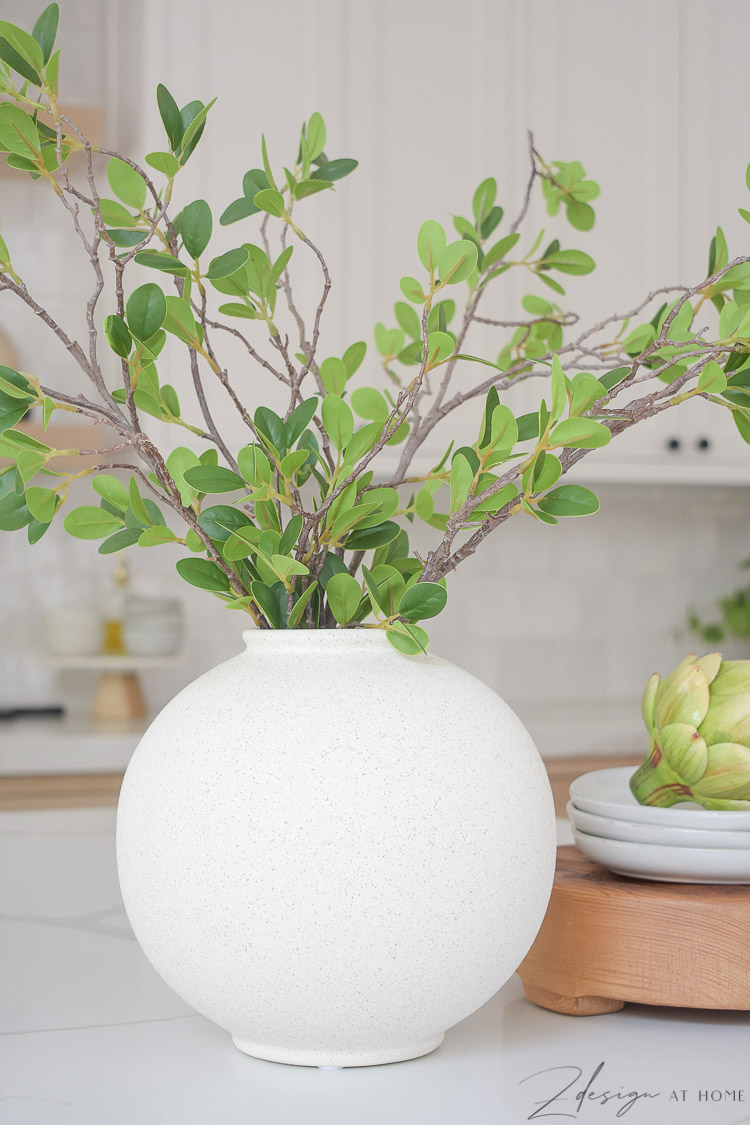 white speckled bubble vase styled on kitchen island