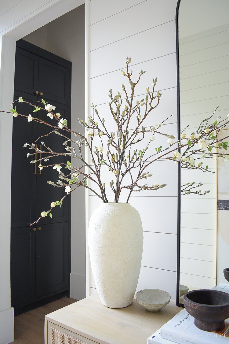 white cream textured vases with faux magnolia and quince stems branches