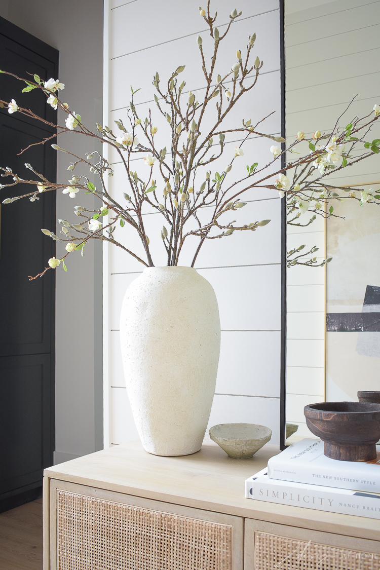 cream white vase styled with magnolia and faux quince stems