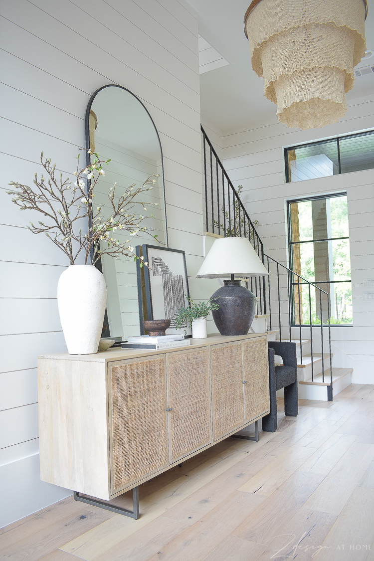 cane console styled in entry way