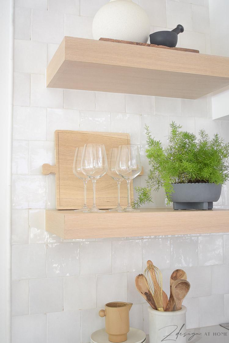 style open shelves in kitchen with white zellige tile backsplash