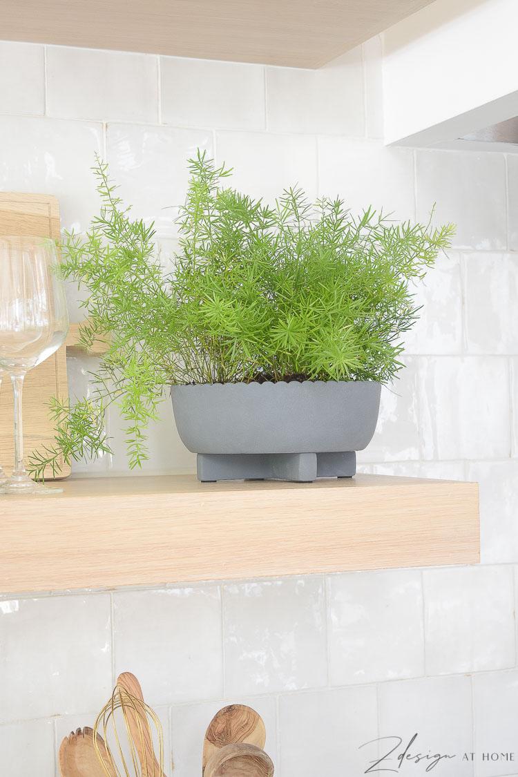gray scalloped pot on open shelves in kitchen styled summer walmart decor