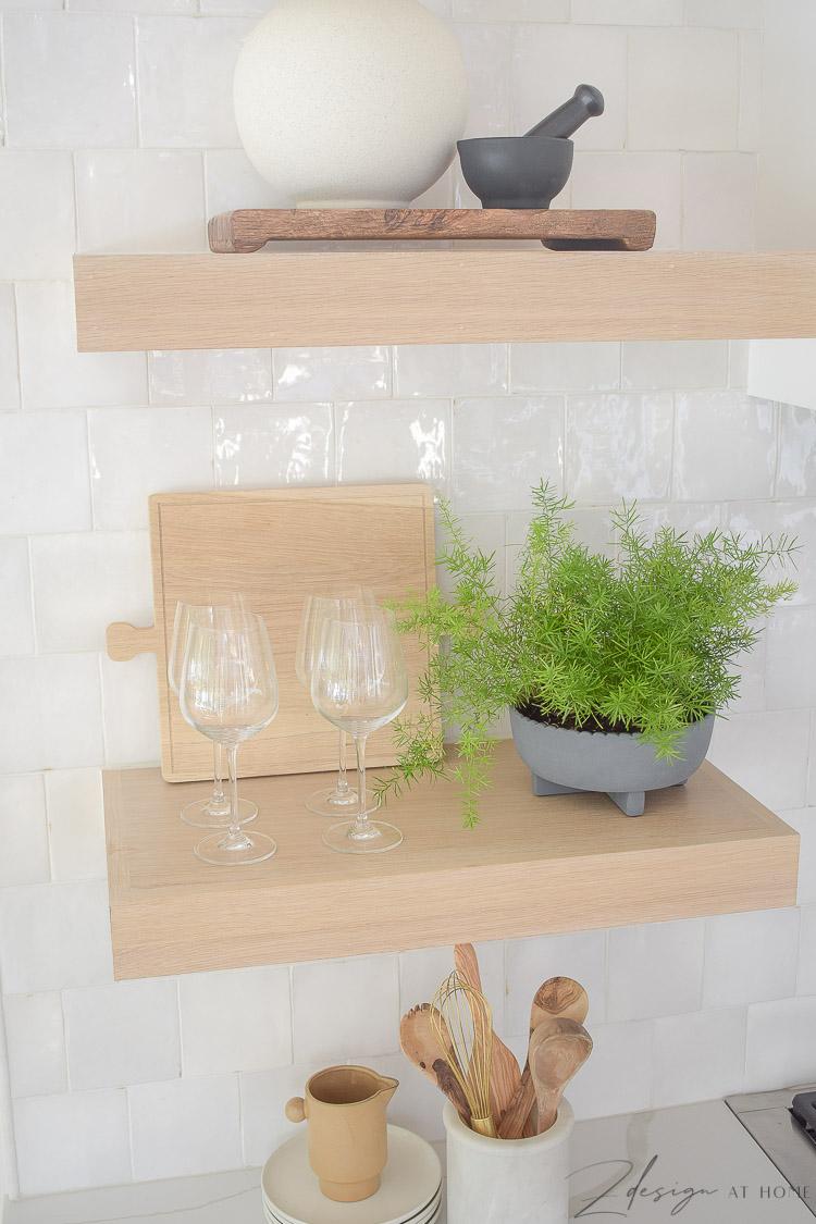 styled open kitchen white oak shelves