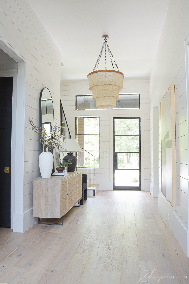 grand entryway hall with boho accents and patrica round chandelier