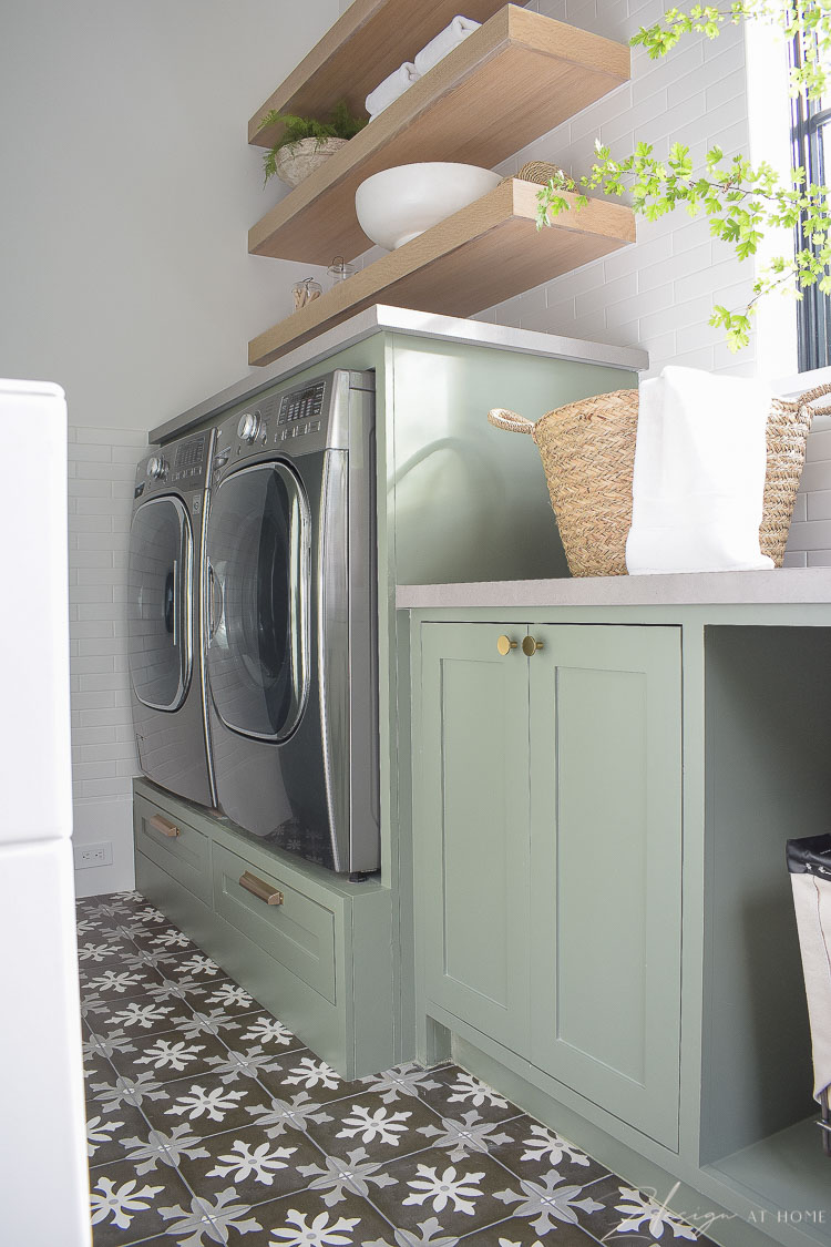 builtin washer and dryer and sw dried thyme paint color on cabinets