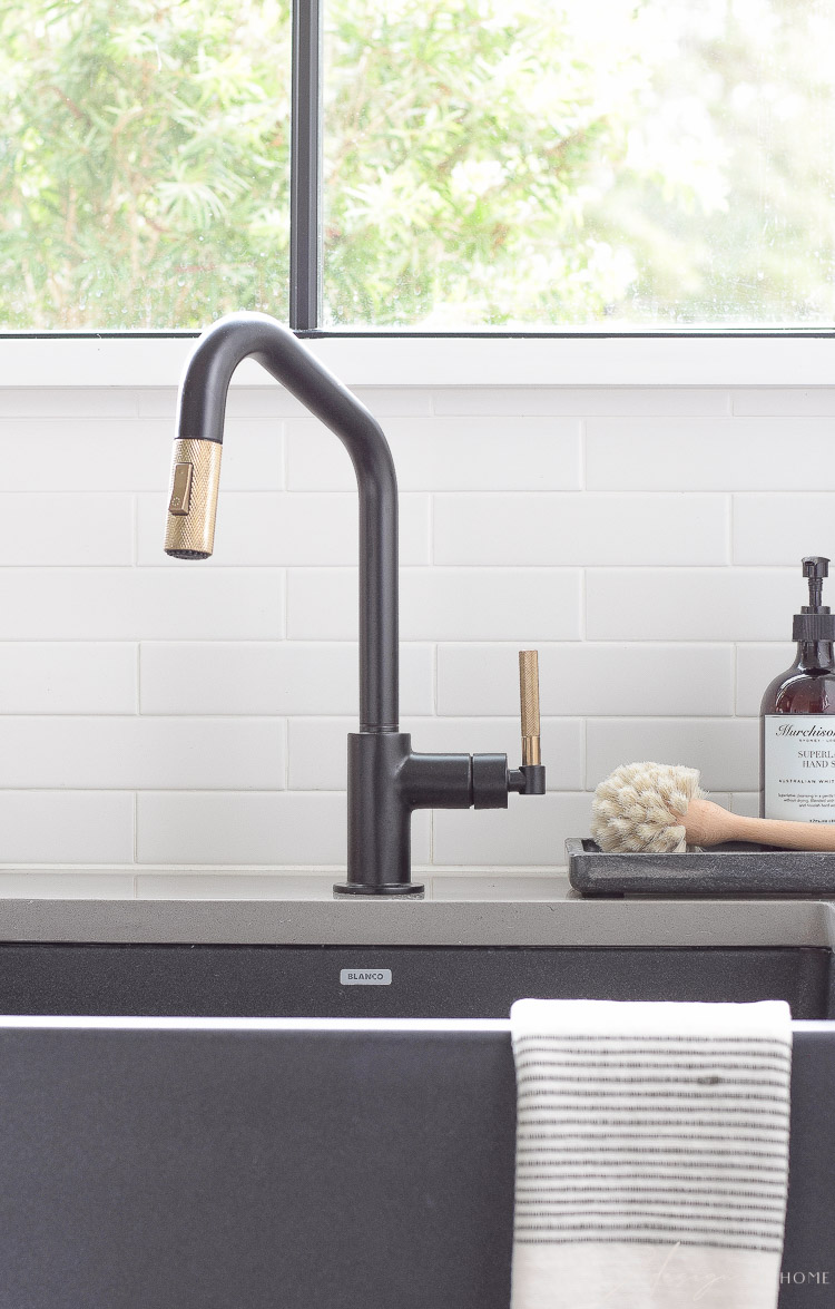 brizo little faucet in black and luxe gold