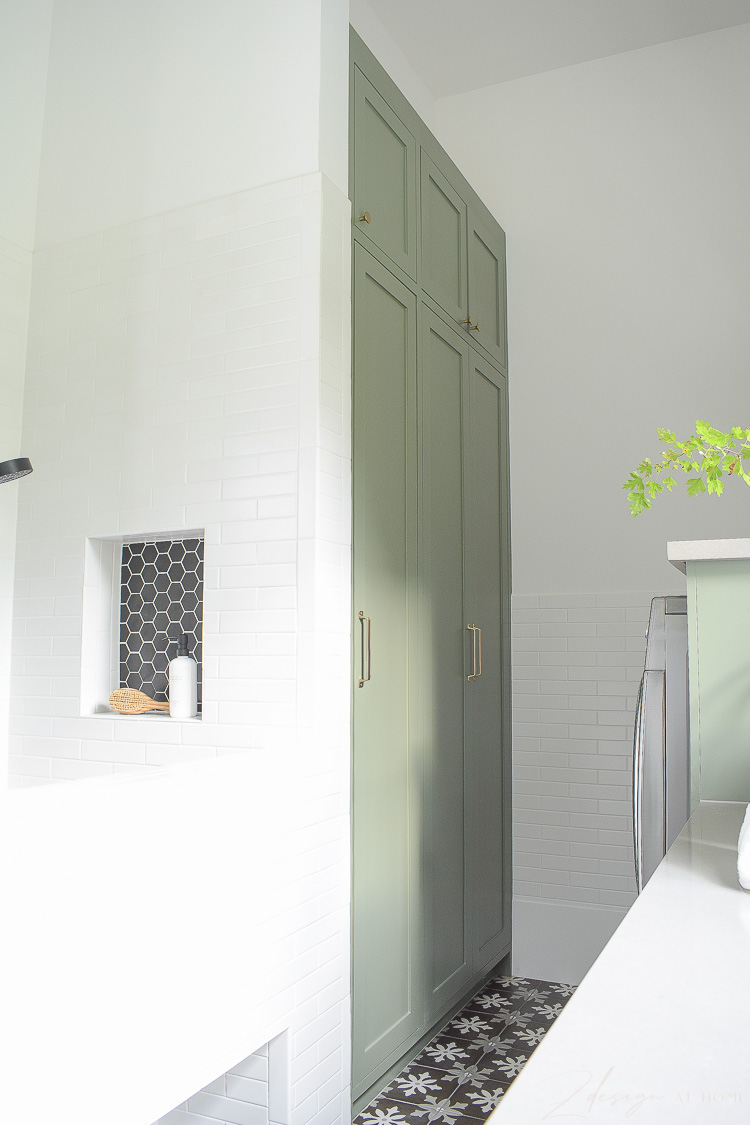 tall green gray cabinets in sw dried thyme in laundry room