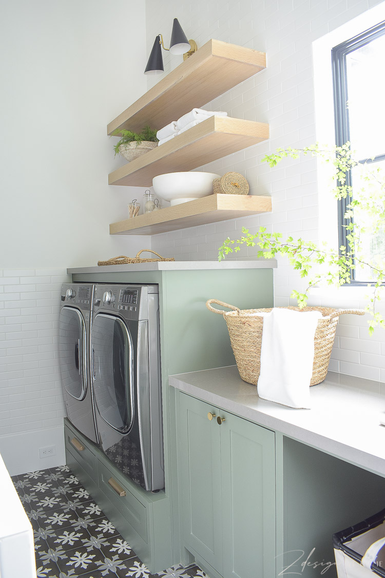 builtin washer and dryer with white oak shelves above
