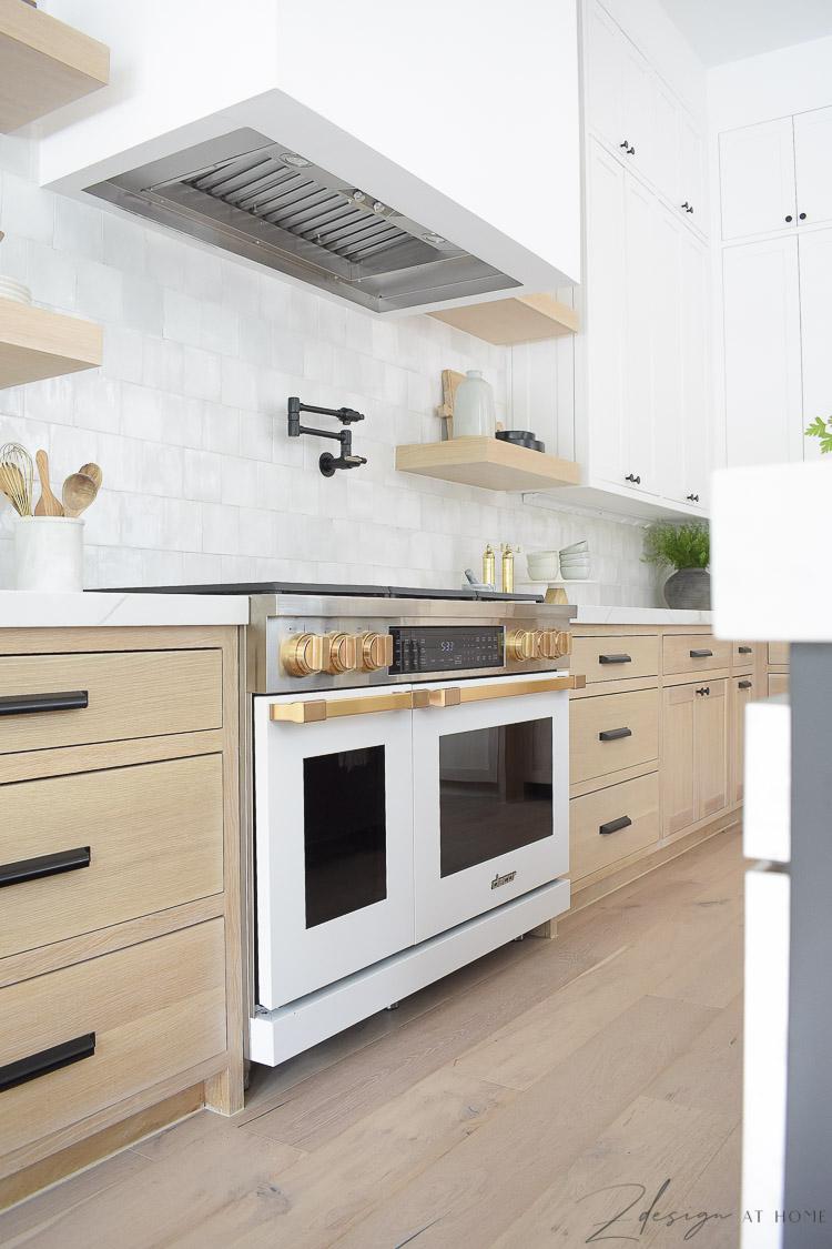 modern farmhouse kitchen with black white and white oak cabinets - white Dacor Range