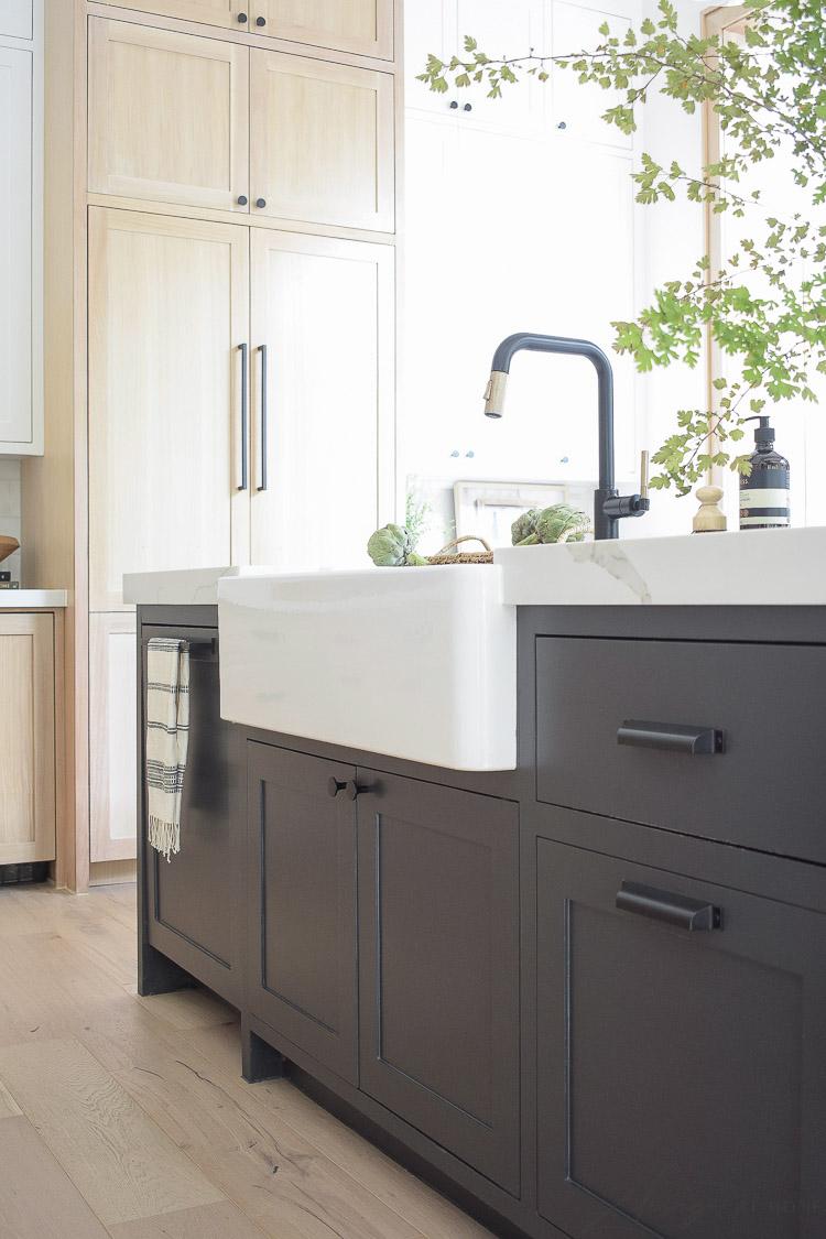 modern farmhouse kitchen with black white and white oak cabinets - blanco sink
