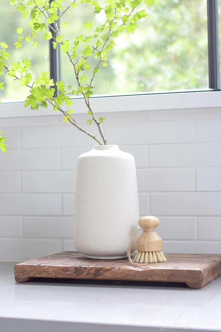 speckled vase in boho setting