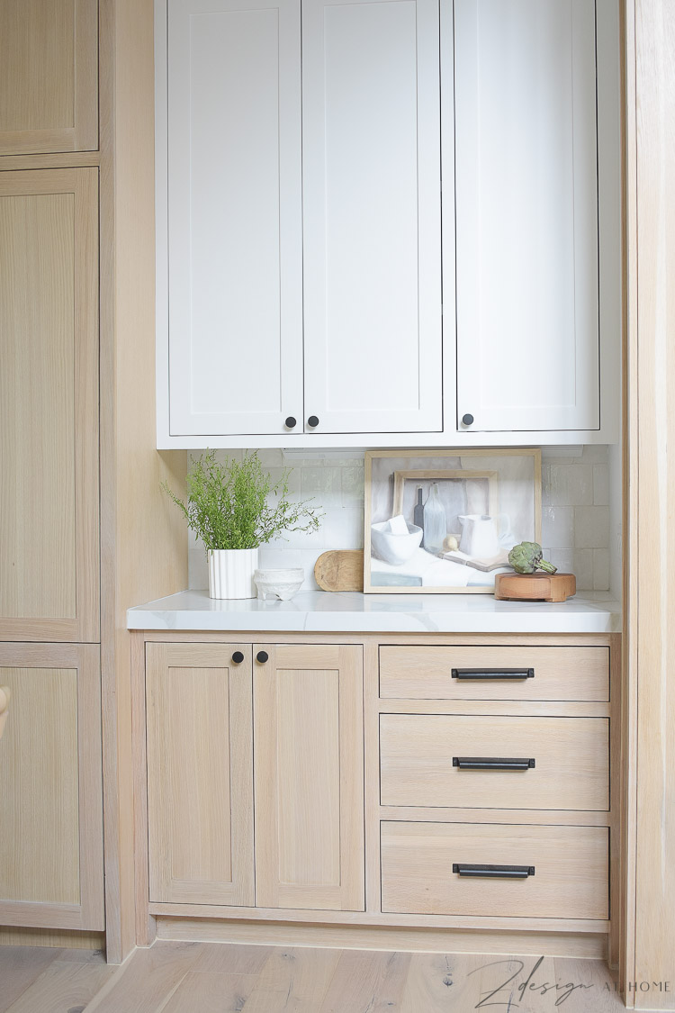 styled kitchen counters with white and white oak cabinets