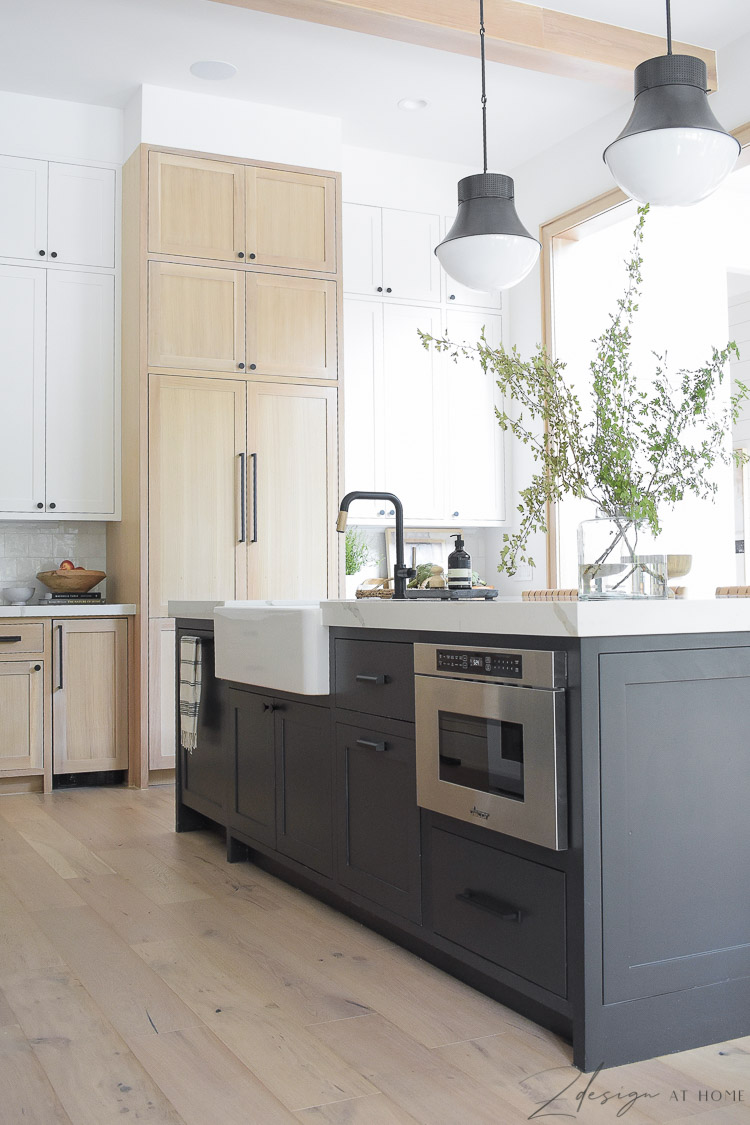 modern farmhouse kitchen with black white and white oak cabinets - black kitchen island