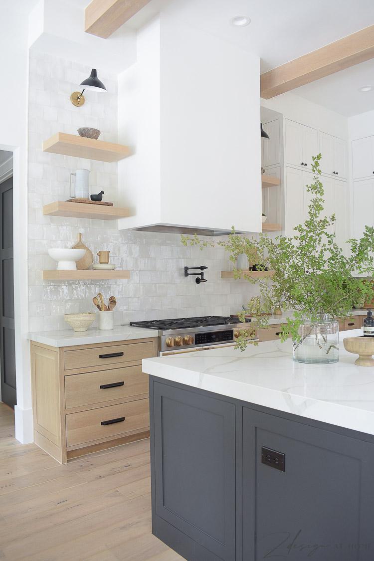 white oak shelves and range hood in modern farmhouse kitchen
