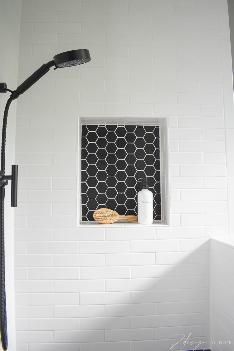 niche for dog wash with white tile and black hex tile with white grout