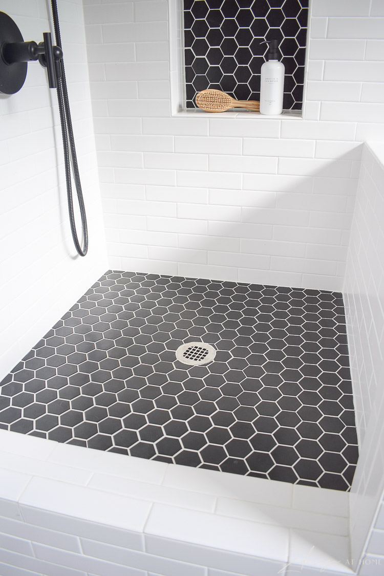 black hex shower / dog wash floor, with white grout