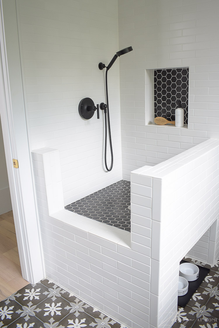 black and white tile dog wash with black hex tile, white grout
