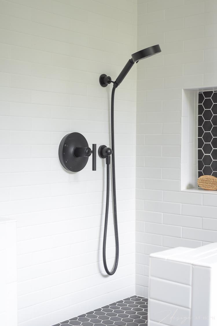 black Kohler hand shower used in dog wash