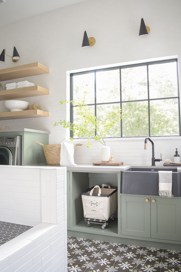 elegant laundry room with gray green cabinets