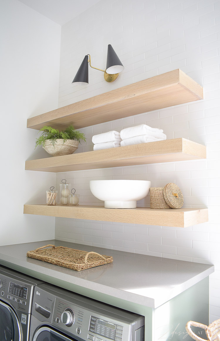 white oak laundry room shelves styled to perfection