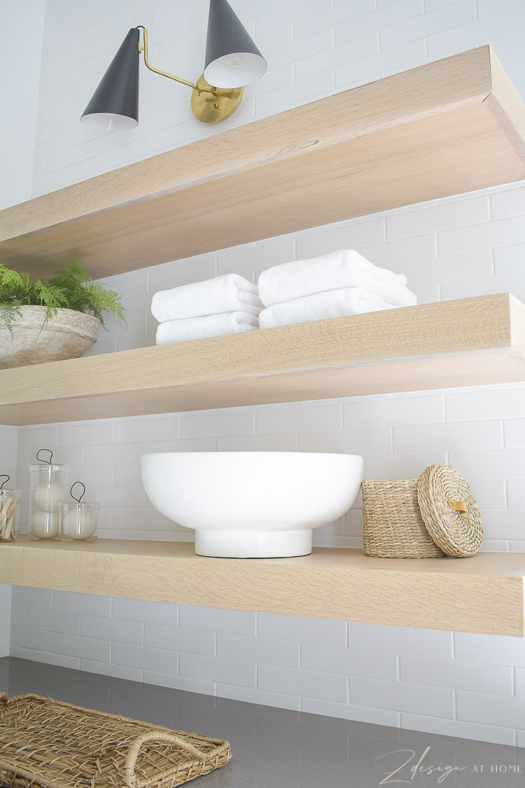 """3"""" white oak laundry room shelves with sconce over head"""