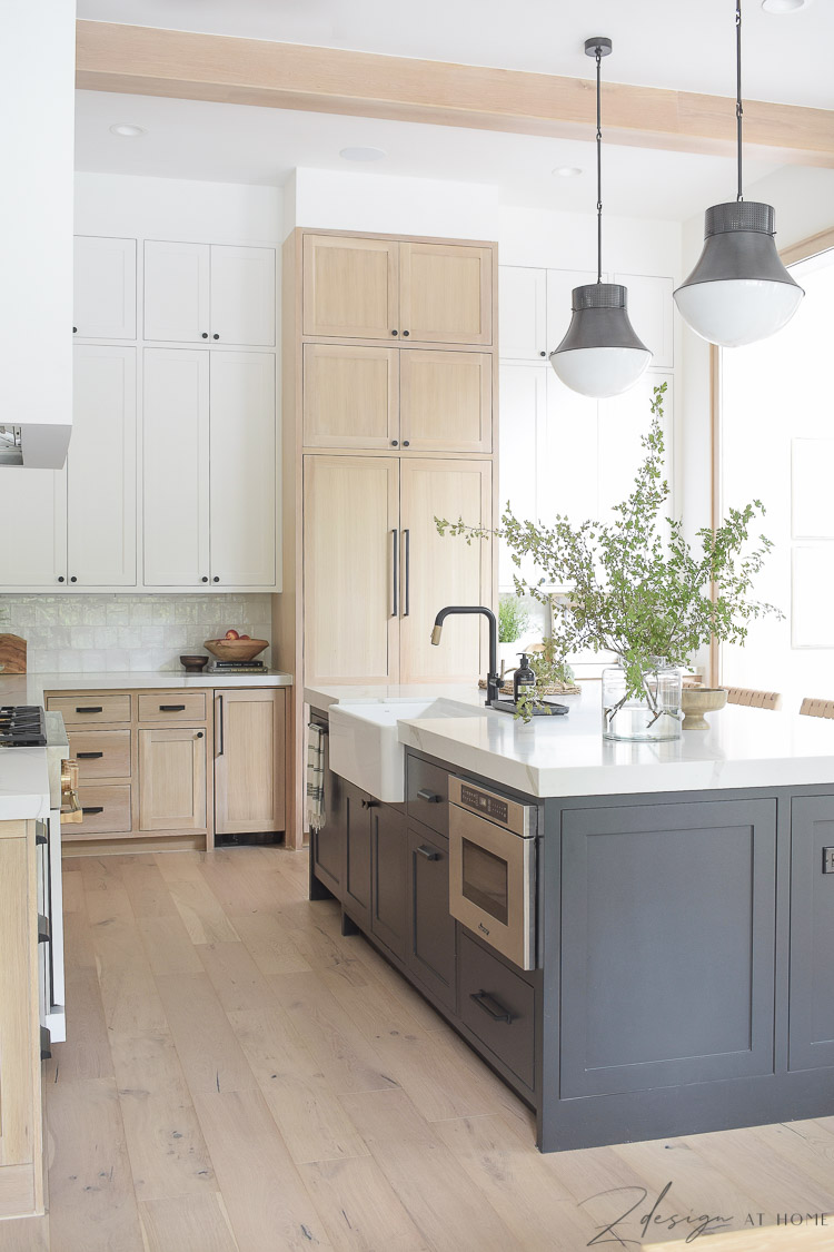 modern farmhouse kitchen with black island white oak cabinets