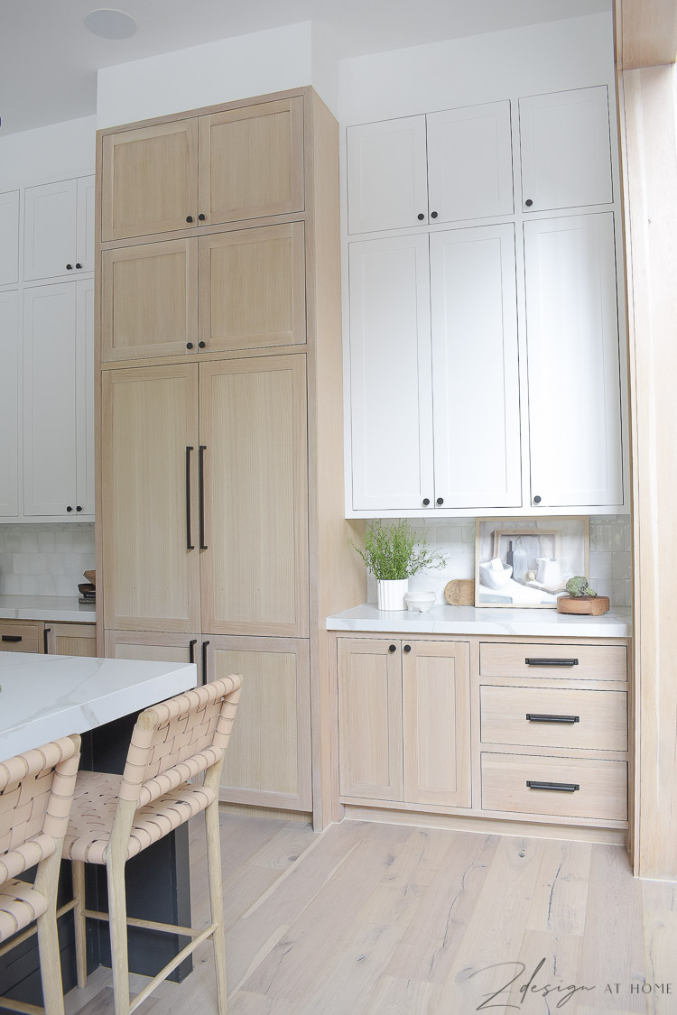 dacor panel ready fridge and white oak \ white painted cabinets in modern farmhouse kitchen