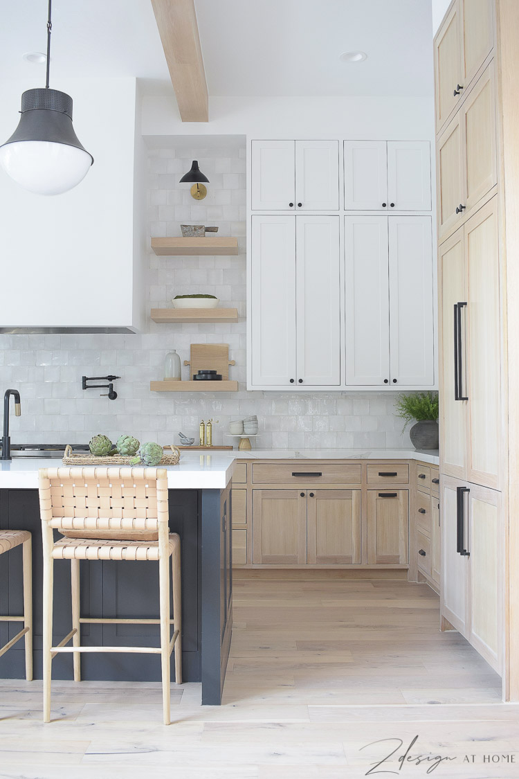 modern-farmhouse-kitchen-white-sheetrock-range-hood-white-oak-shelves-kitchen-with-three-cabeinet-colors-kelley-wearstler-precision-pendant