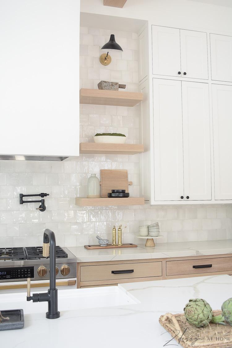 white oak open shelves in modern farmhouse kitchen with white zellige backsplash