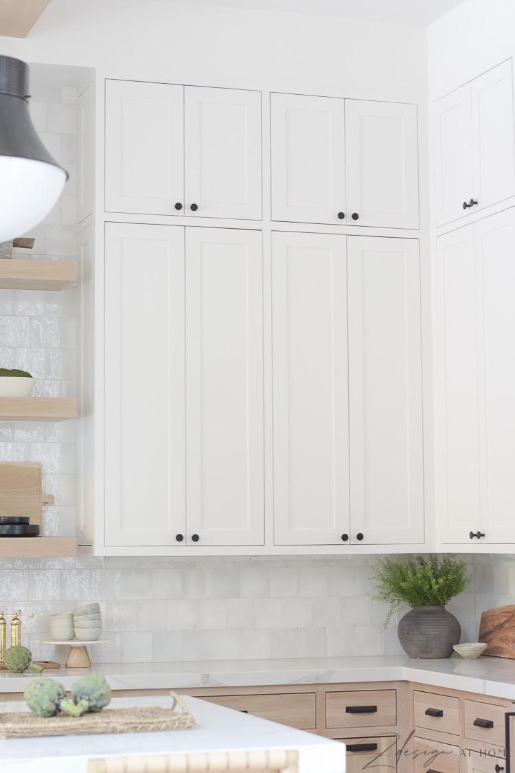 white cabinet uppers in sw snowbound in modern farmhouse kitchen