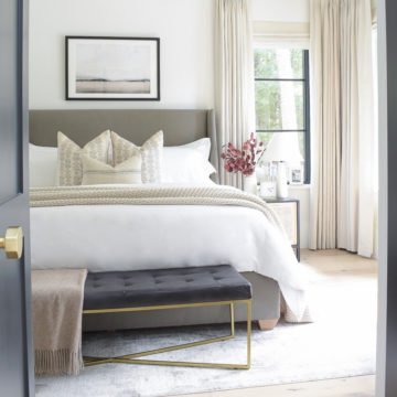 transitional modern master bedroom with black tufted leather bench at end of bed - gorgeous primary bedroom, high end