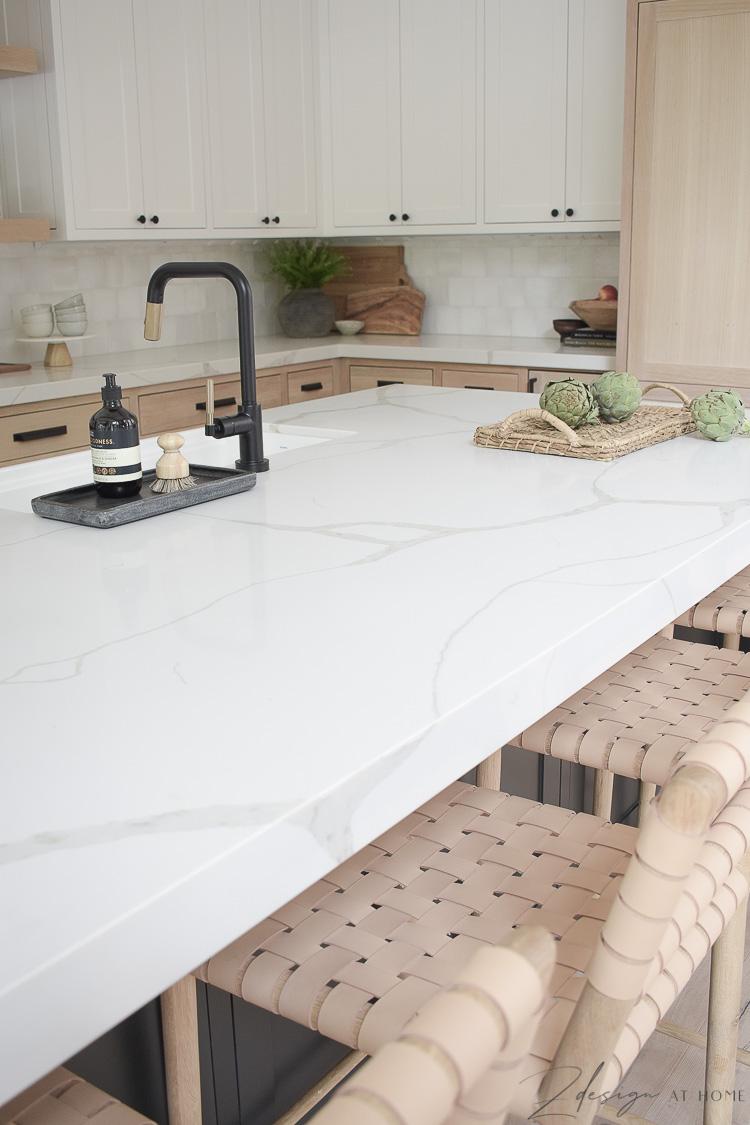 calafata nous quartz countertops in white with veining