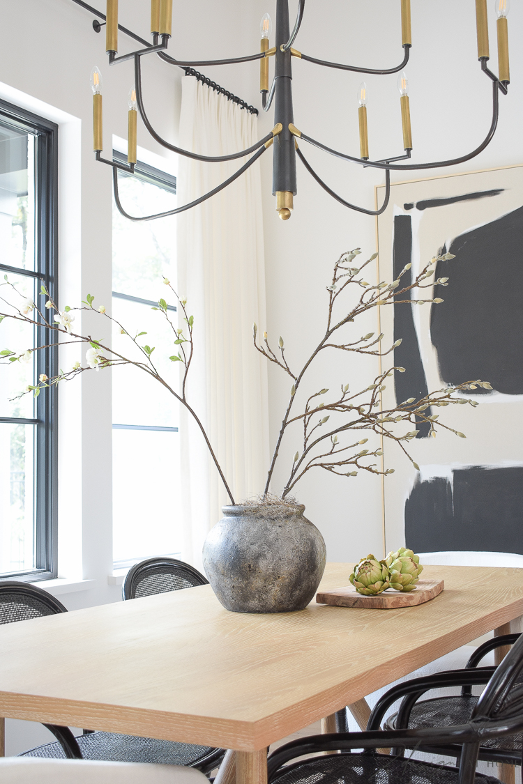 transitional modern farmhouse dining room with black and white theme and oversized art