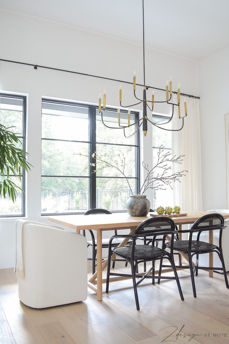 transitional modern farmhouse dining room with black and white theme and oversized chandelier