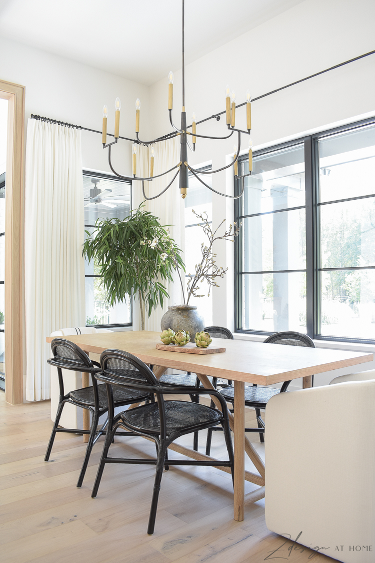 modern farmhouse dining table with black cane rattan side chairs