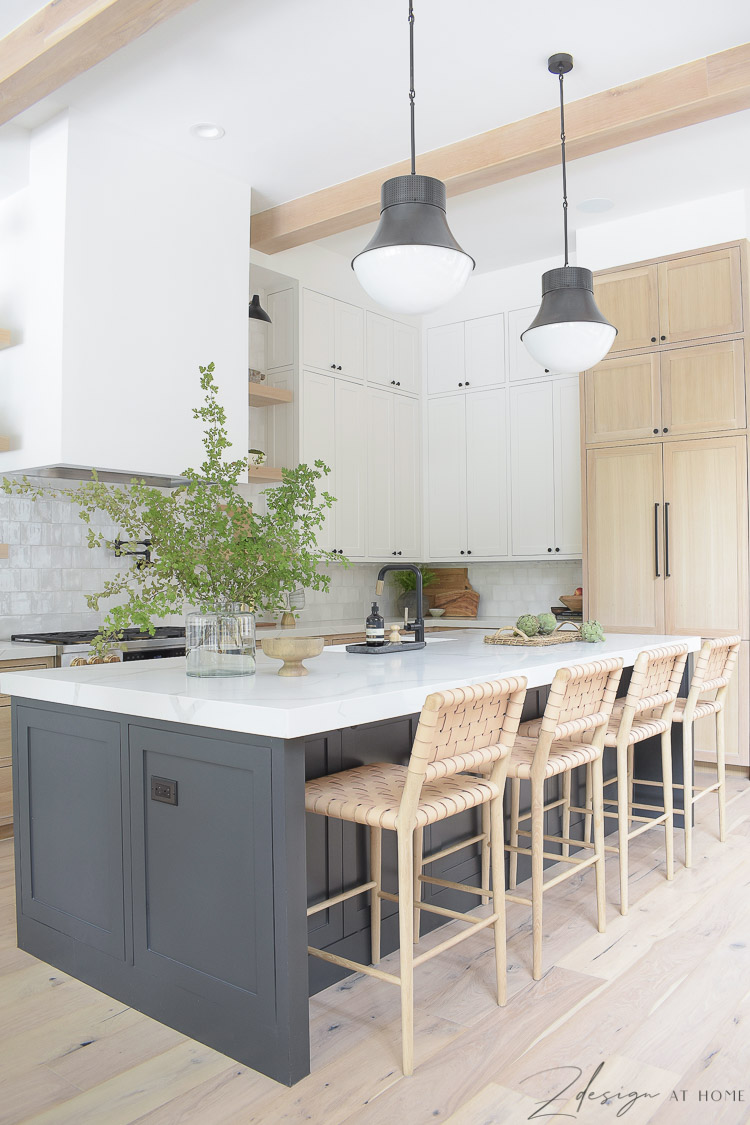 modern farmhouse kitchen with black island, white cabinets, white oak cabinets