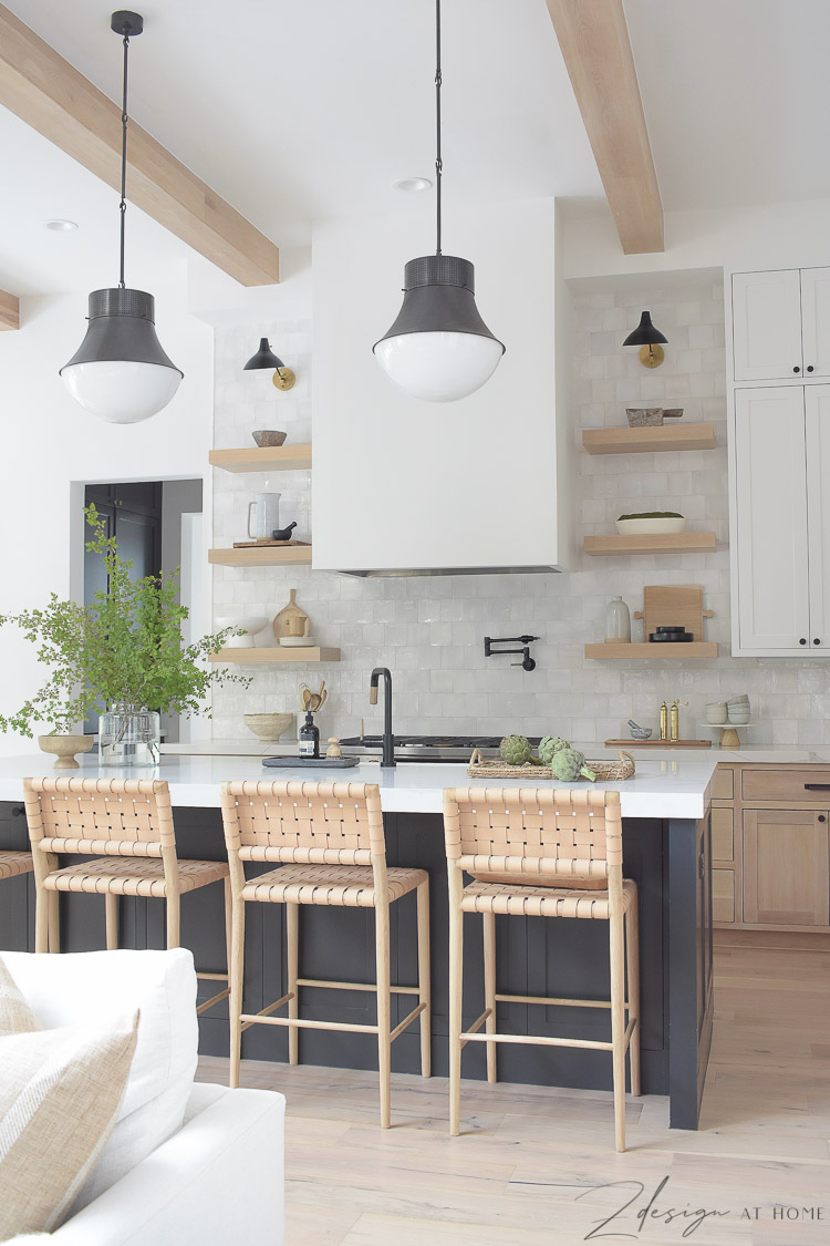 Modern farmhouse kitchen in black, white and white oak with zellige backsplash and quite quartz countertops with veining
