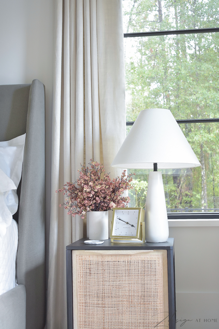 black and natural cane nightstand styled with fall faux stems