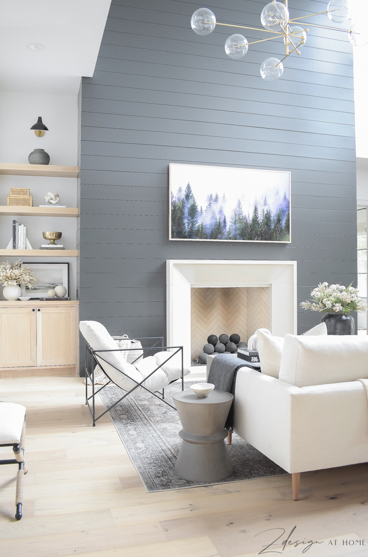 fall living room with black shiplap fireplace