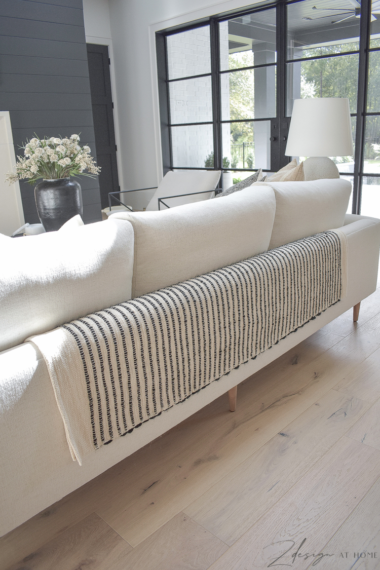 black and cream textured throw over back of sofa