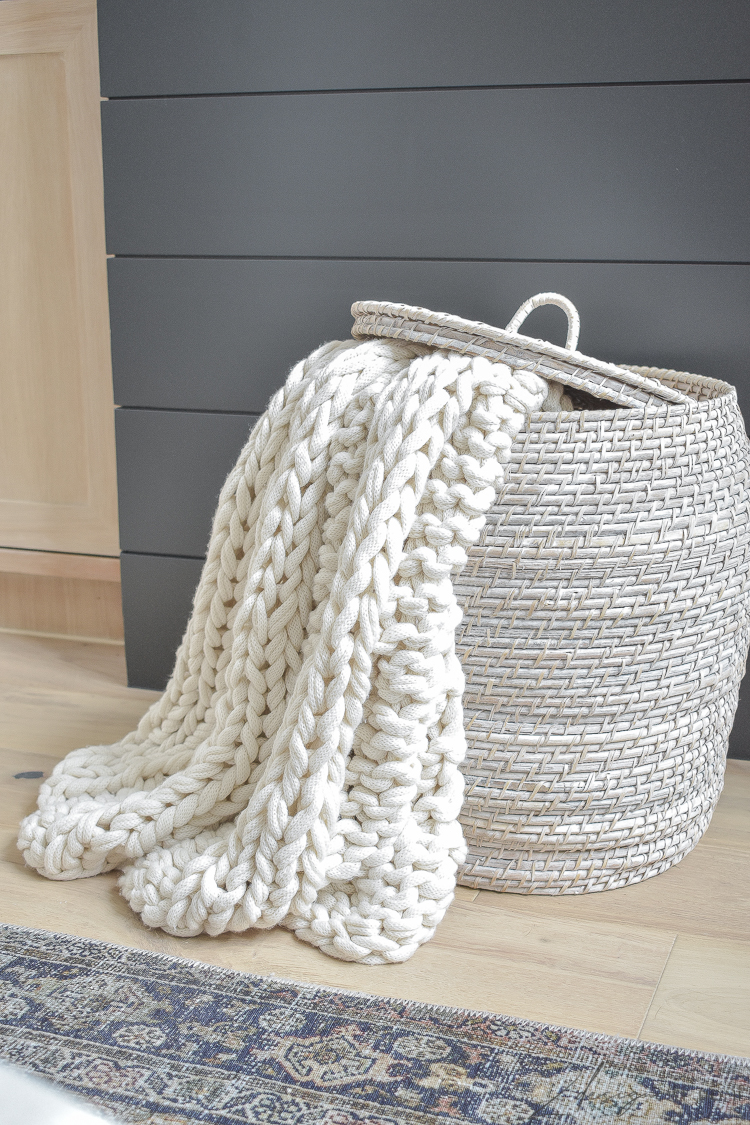 cream chunky knit throw in basket