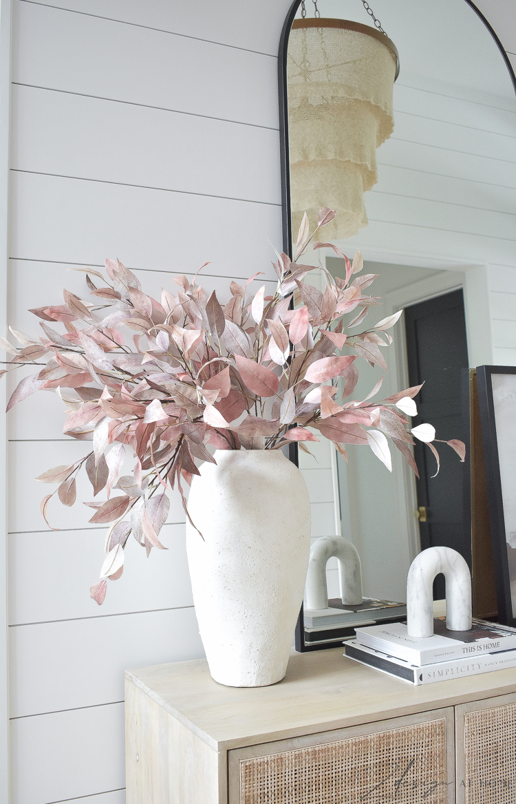 white texture vase with fall stems and march arch accessory