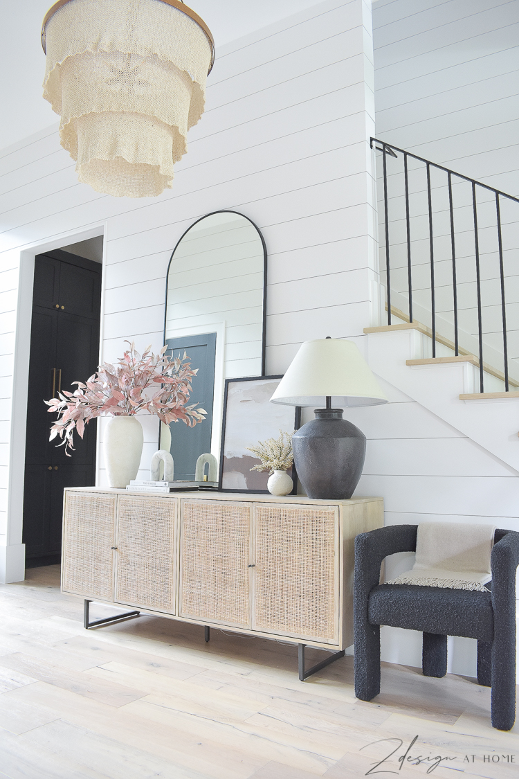entryway decorated for fall with shiplap walls