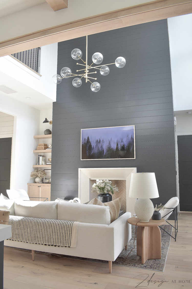 transitional modern living room styled for fall and black shiplap wall/fireplace